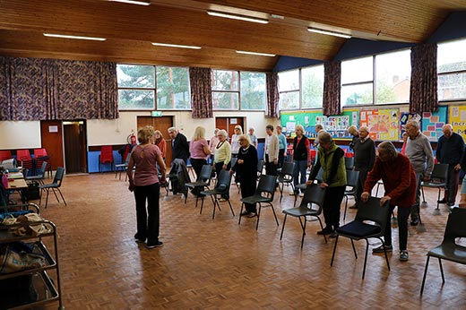 Active seniors meeting in the church hall